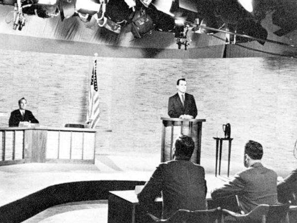 Suave vs. Sweat: John F. Kennedy and Richard Nixon take the stage in Chicago during the nation's first televised presidential debate in 1960.